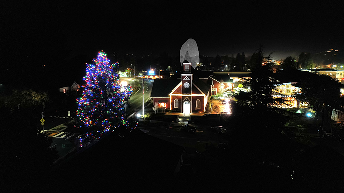 christmas%20tree%20lit%20in%20public%20place%20-church%20with%20steeple
